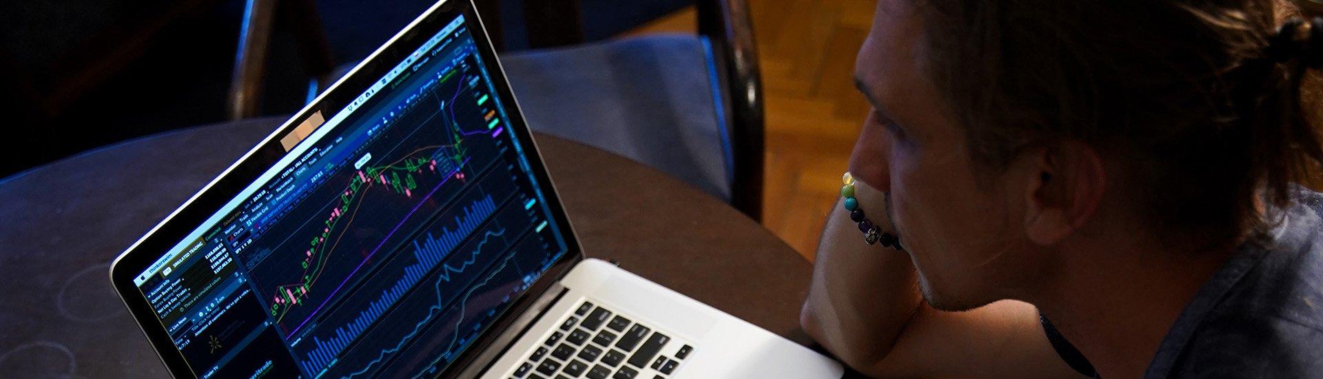 man-looking-at-laptop-data